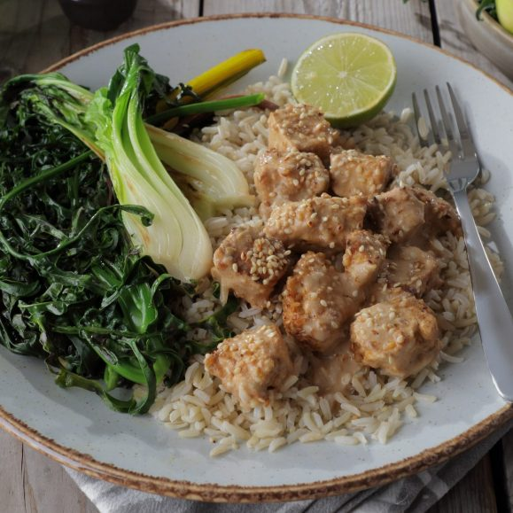 Spicy Tofu Served with a Peanut and Coconut Sauce and Wilted Greens